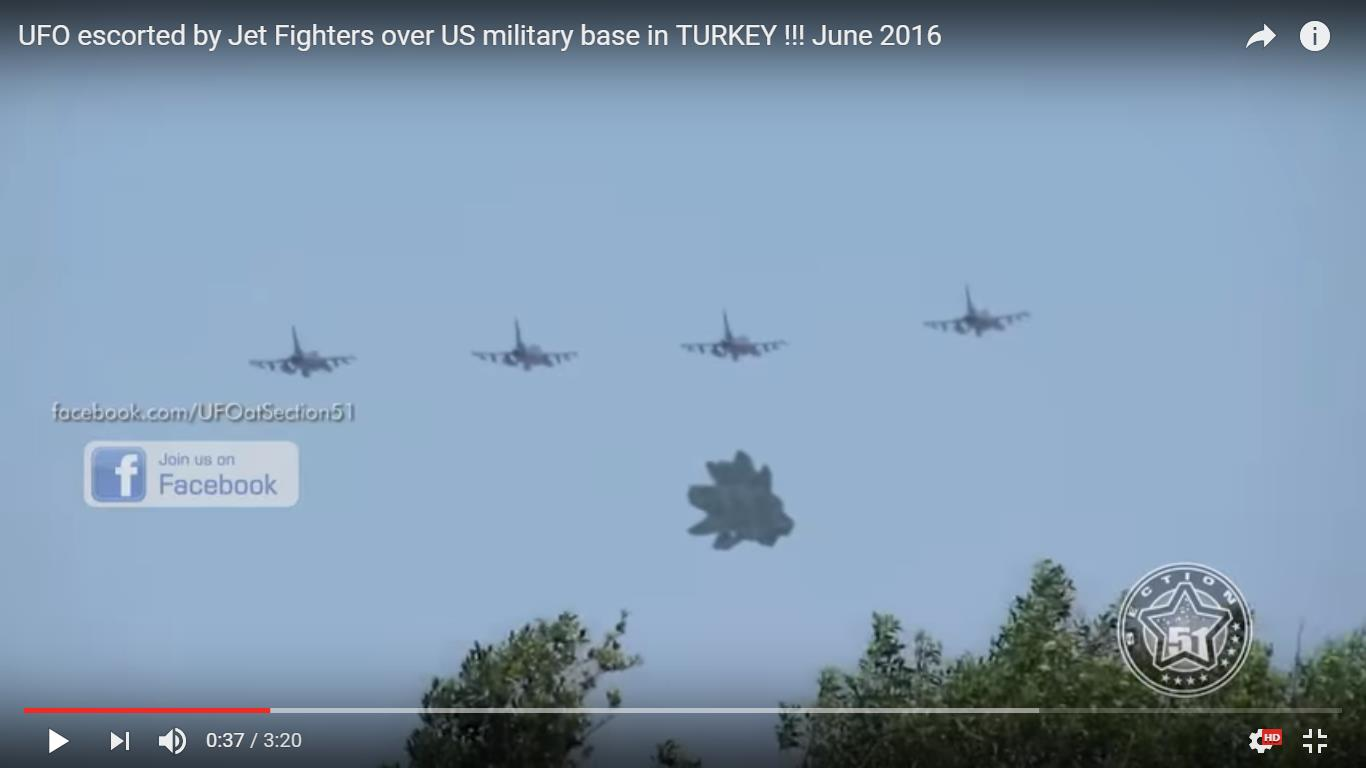 UFO escorted by Jet Fighters